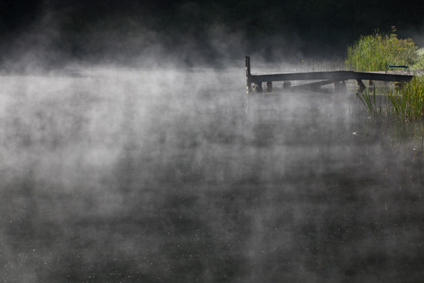 Morning mist rises from a Pomfret, VT, pond.