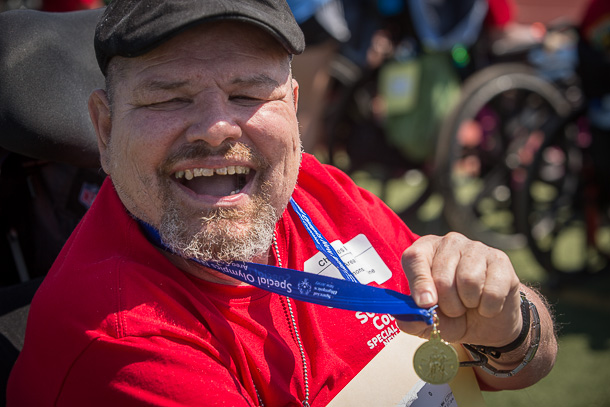 Charlie shows off another gold medal he won at the Special Olympics.